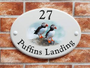 house sign with puffins picture